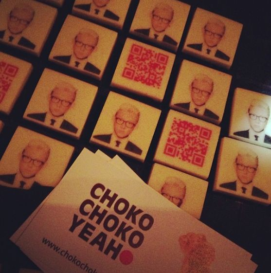 Chocolates with the birthday boy's photo. And when the guests scanned the QR code, it linked to what came up when you google him :)