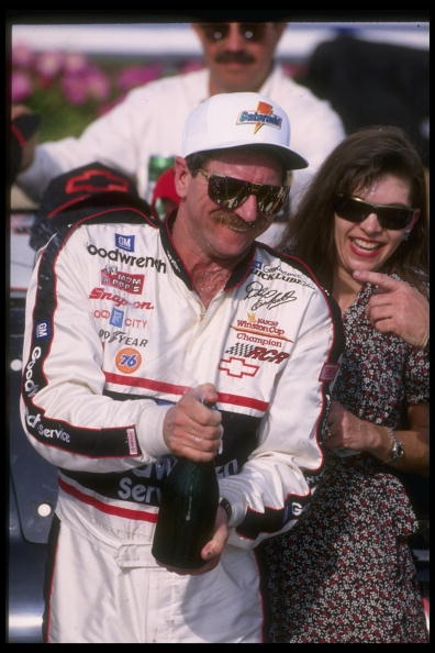 DAYTONA BEACH - FEBRUARY 19 Feb 1995: Dale Earnhardt Sr. driver of the #3 GM Goodwrench Chevrolet celebrates with his wife Teresa and a bottle of champagne after finishing second in the NASCAR Daytona 500 on February 19, 1995 at the Daytona International Speedway in Daytona Beach, Florida. (Photo by Andy Lyons/Getty Images)