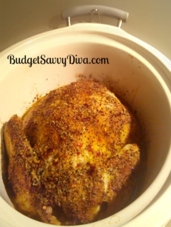 Crock Pot Whole Chicken. I put olive oil and seasoning under the skin and then more olive oil.