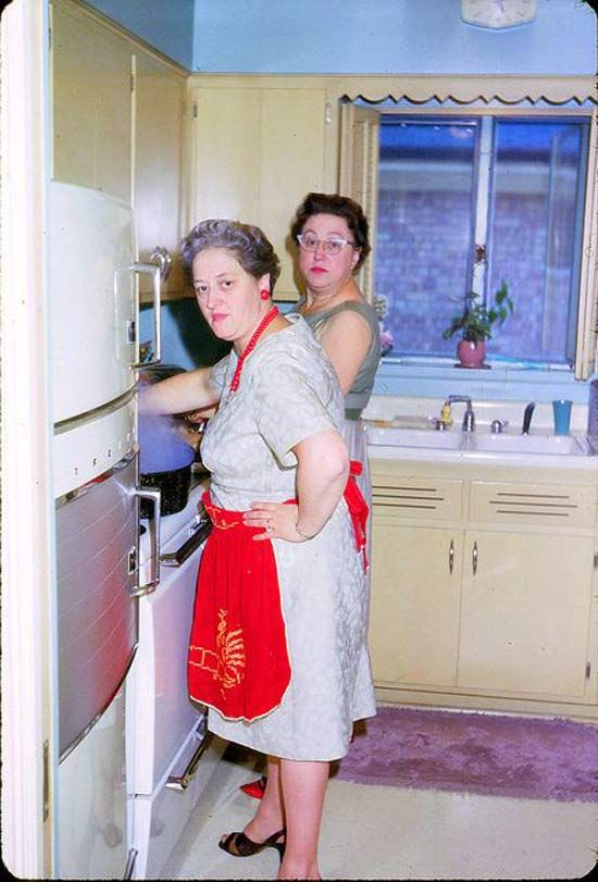 Vintage color snap of old ladies, moms, grandma's cooking in kitchen, 1950s ~Awkwardly Funny Family Photos