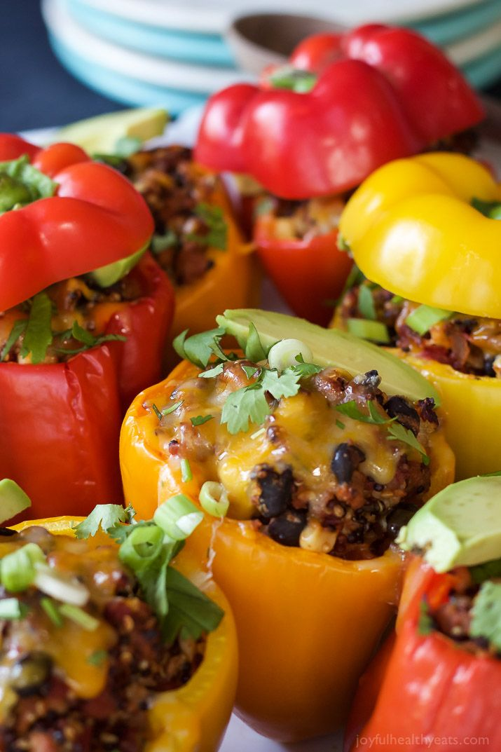 Southwestern Turkey Quinoa Stuffed Peppers filled with loads of protein and bold flavors that will leave you feeling satisfied and hungry for more all at the same time! Only 262 calories a serving!   joyfulhealthyeats.com #recipes