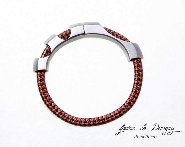 "$480 ""Over the Bridge"" men's bracelet. Silver, mountain climbing cord and super cool magnets http://www.janinededorigny.com/product-category/collection/"