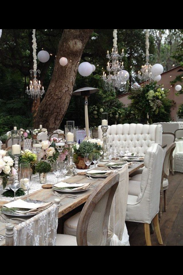 Love the rustic setting for backyard party and love the tufted banquet for use in the kitchen with a farm table and bench.