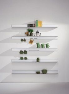 Shelf and profile in anodised matt silver aluminium hung to the wall by Bdbarcelona design