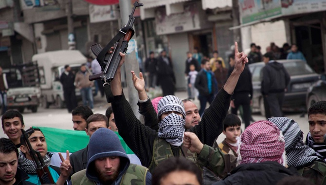 How Climate Change Worsened Violence in Syria. International security experts explain how low rainfall can evolve into violent conflict.. Syrian rebels rally in Aleppo last November. Pau Rigol/ZUMA
