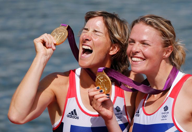 Great Britain's Katherine Grainger and Anna Watkins display the gold medals they won in the women's rowing double sculls in Eton Dorney, near Windsor, England, Aug. 3, 2012.