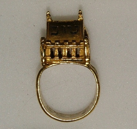 Jewish marriage ring  16th century  Gold Jewish marriage ring, the hoop stamped with groups of four trefoils punched with chevron borders; the rectangular edicule with sixteen pierced windows, steep gabled roof and six pinnacles (one lost). One side pierced with Hedrew inscription, Mazal tov (good luck).