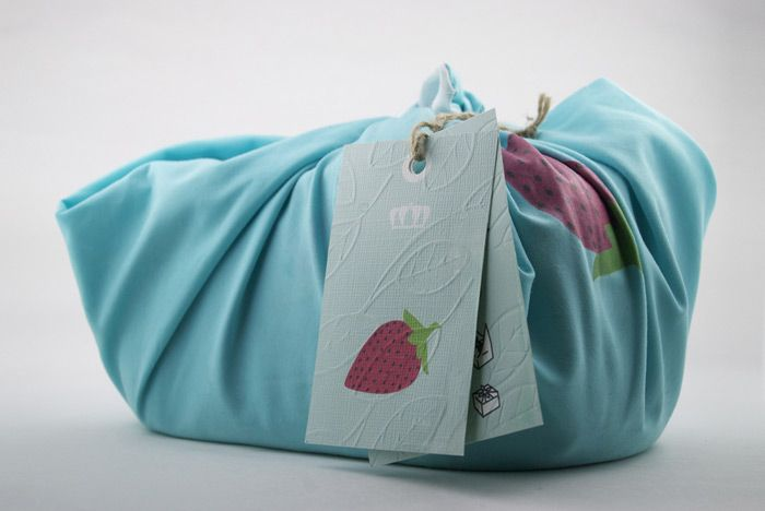 lovely way to package bread in a linen cloth that can be reused so saves on plastic packaging