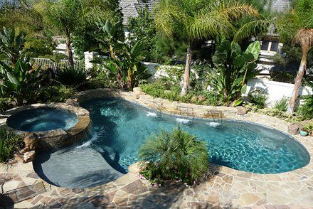 Nice pool design with palm trees in the back.