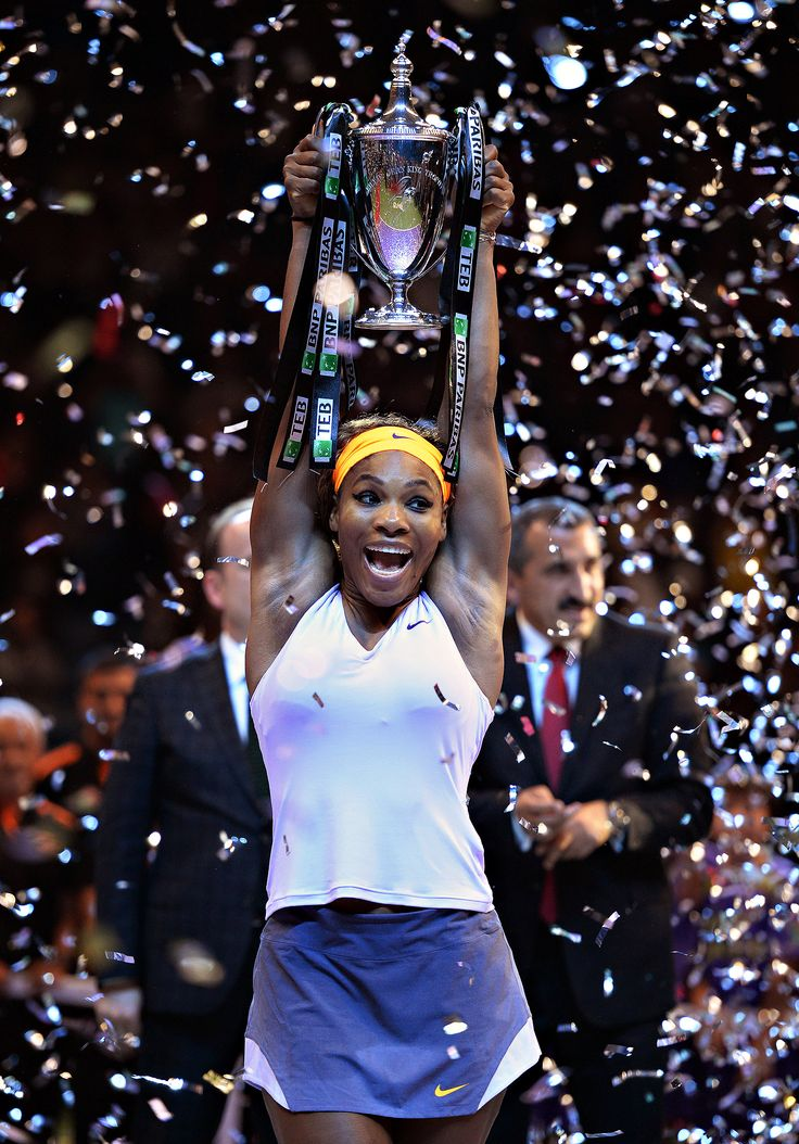 Serena Williams with the the Billie Jean King Trophy after winning the season-ending WTA Championships (2013)