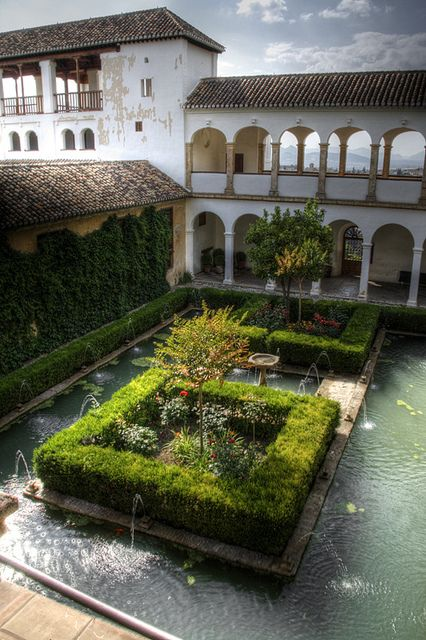 Lots of open air living, view, green wall, pond, and a bird bath the cats can't get to. Love it.   Patio del ciprés de la sultana. Generalife. Alhambra. Photo by J. A. Alcaide via Flickr.