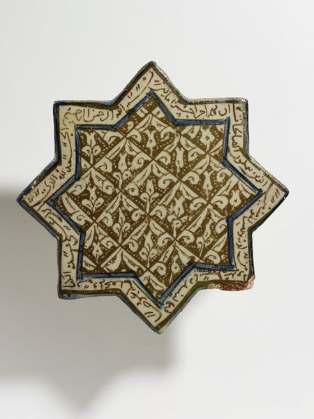 Tile      Place of origin:      Kashan, Iran (made)     Date:      early 14th century (made)     Artist/Maker:      unknown (production)     Materials and Techniques:      Fritware, glazed and painted in cobalt blue and lustre     Museum number:      1828D-1876