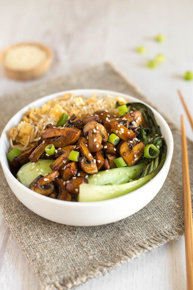 Teriyaki mushroom egg fried rice bowls - simple homemade egg fried rice, topped with steamed pak choi and DELICIOUS teriyaki mushrooms! The sauce is sticky, sweet and salty - and it's vegetarian and gluten-free too!