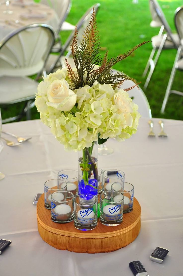 Wood, outdoor, hydrangea, roses, lake, reception centerpiece for wedding