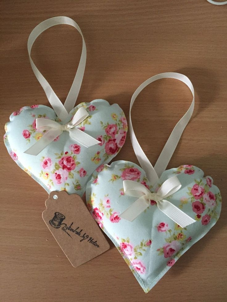 Handmade by Helen Two handmade decorative hearts. Both in floral material with a cream bow.  Each heart measures approximately 10cm in height and 12cm in width. Perfect for hanging on doors etc. All items come gift wrapped!  Handmade in a pet and smoke free environment Feel free to ask any questions and please check out my other items. I also sell bunting to match!  Please allow 3working days for dispatch, as most items are made to order. If you do have any specific requests…
