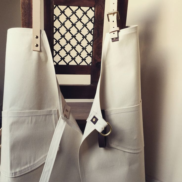 Bull Denim aprons with brass metal work and chestnut/natural leather strapping. For a barista client