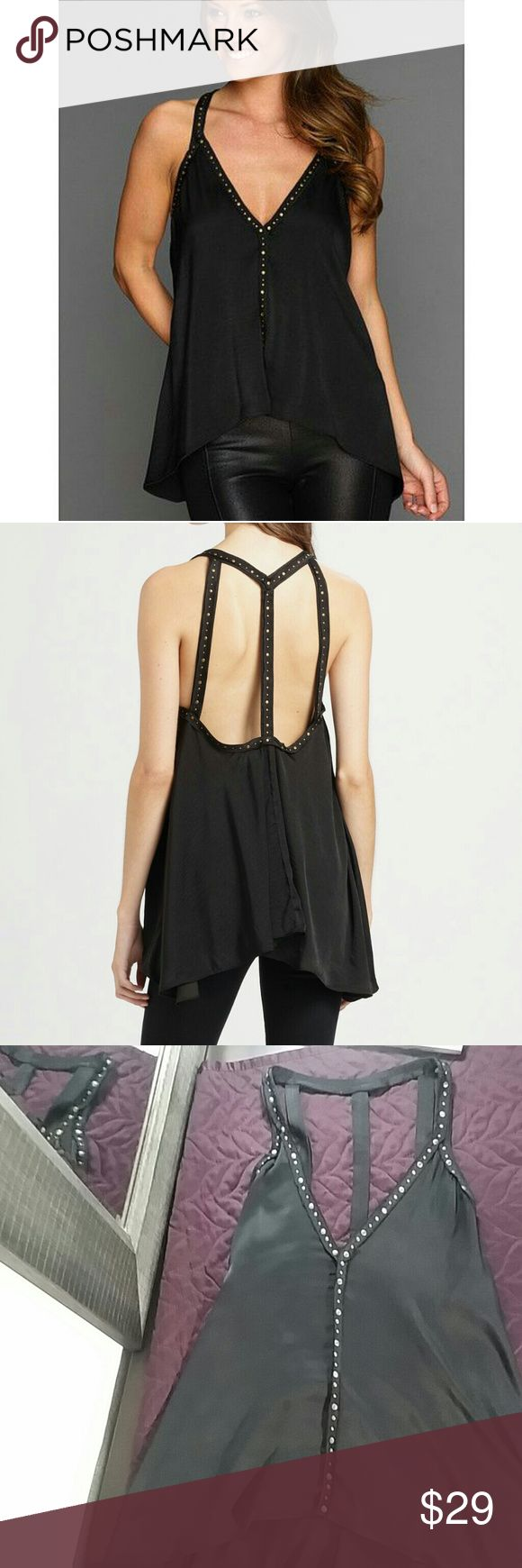 BCBGMAXAZRIA WOMENS V-NECK STUDDED OPEN BACK TOP Shimmering v-neck with an open back, a contoured hem and edgy-chic studded trim. V-neck Sleeveless Studded trim Contoured hem Exposed back Polyester Dry clean Imported MSRP $178.00 Model: Abbey BCBGMaxAzria Tops Blouses