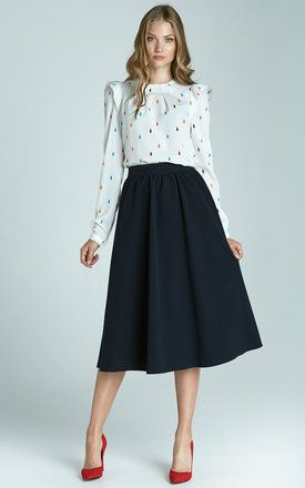 You can't go wrong with a navy midi skirt. It can be dressed down with a simple blouse for the office, or paired with a cute lace top and heels for the evening!
