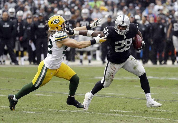 packers raiders clay matthews   Oakland Raiders running back Latavius Murray (28) stiff-arms