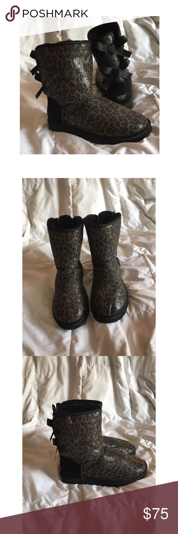 🐾Cheetah print UGG BOOTS 🐾 Authentic cheetah print ugg boots size 8 glittery, and has bows on the back, no stains or rips! It's in excellent condition!! UGG Shoes Winter & Rain Boots