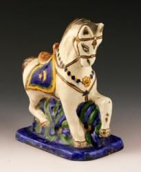 "Persian figure of a horse, glazed ceramic, 7"" h x 7"" w."