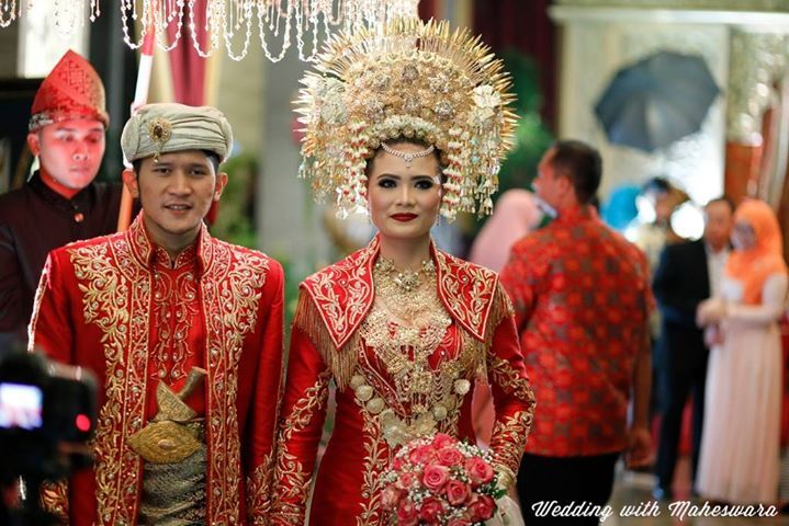 Minangkabau West of Sumatra bride with her awesome crown in traditional wedding.