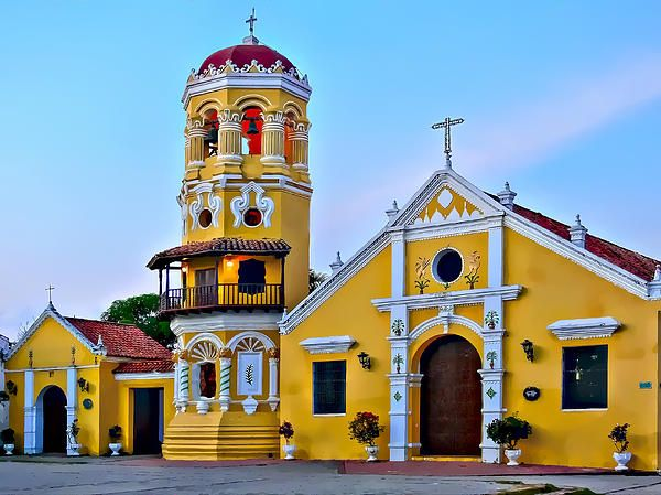 Santa Barbara Church in Mompox, Colombia. Mompox or Mompos, officially Santa Cruz de Mompox, is a town and municipality in northern Colombia, in the Bolivar Department, which has preserved its colonial character. Located on an island in the Magdalena River where it joins the Cauca River, 249 kilometers from Cartagena.   Proceeds from the sale of this photograph goes to help orphaned and abandoned children in Colombia South America.