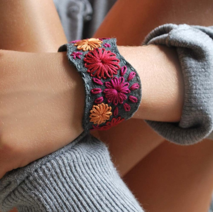 Felt Bracelet Hand Embroidered Cuff Embroidery Pewter Grey Wool Felt with Magenta Orange Red Stitching by lovemaude. $26.00, via Etsy.