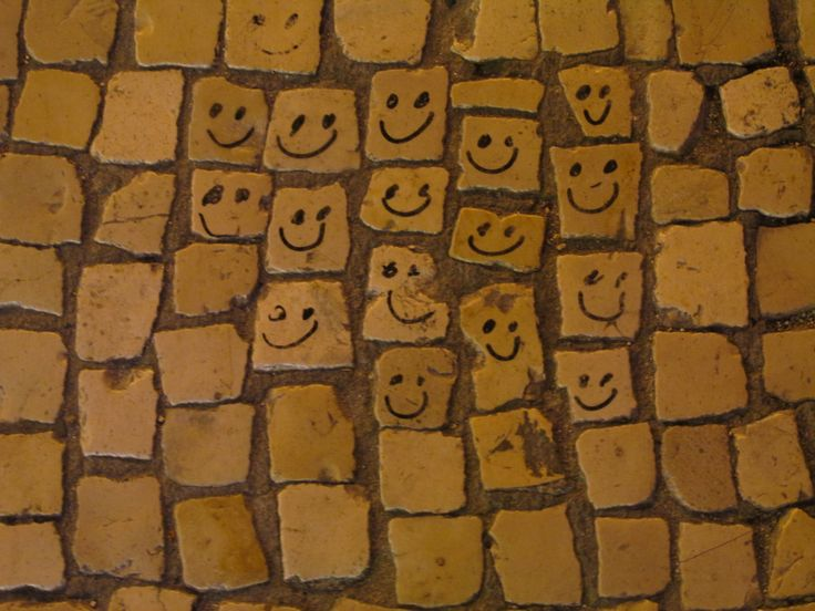 Smiles on traditional Portuguese paving in Lisbon