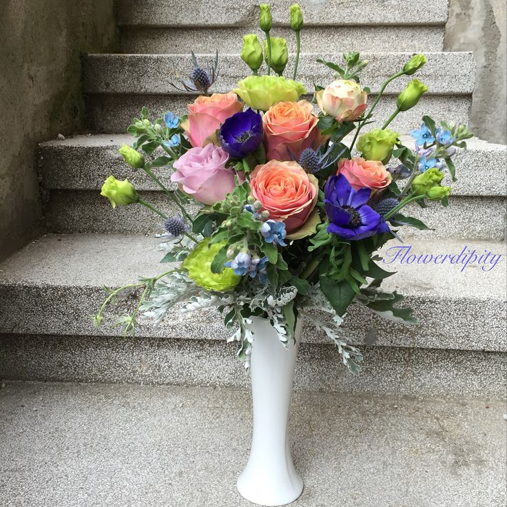 Colorful flowers arrangement #colorful #flowers #peach #roses #blue #anemone #green #silver
