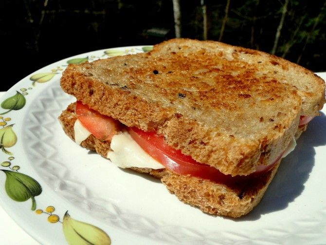 Grilled cheese with Tomato and Provolone.  The provolone and tomato grilled cheese is perfect. It is very gourmet but the ingredients required are really affordable. The sandwich is fresh, has great texture, is cheesy and will keep you filling full longer. All you need is some good quality bread, butter, cheese, tomato and a few extras if you want to amplify the sandwich a bit more.