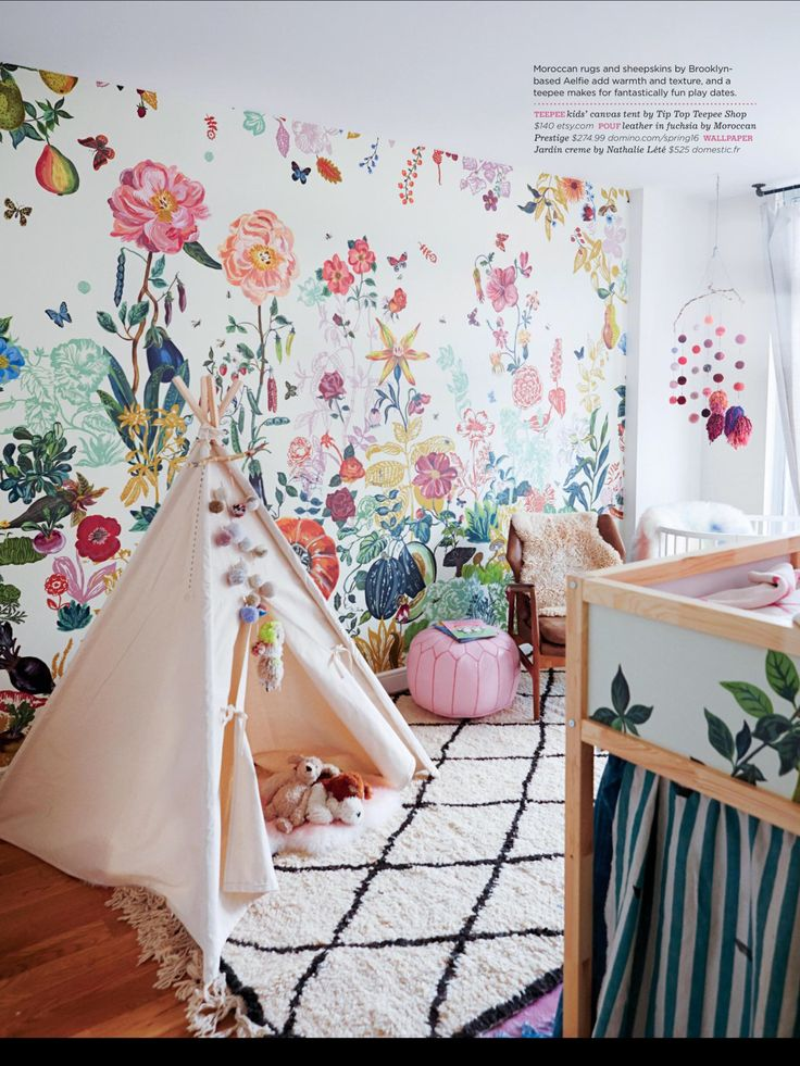 Stokke Sleepi mini crib in white spotting in this colorful eclectic nursery room featured in DOMINO MAGAZINE