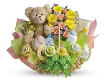 Lucky bear! Make the new parents smile with this charming basket filled with flowers, assorted baby care essentials and a gorgeous teddy bear. Accented with a green satin ribbon, this thoughtful basket is sure to bring joy!