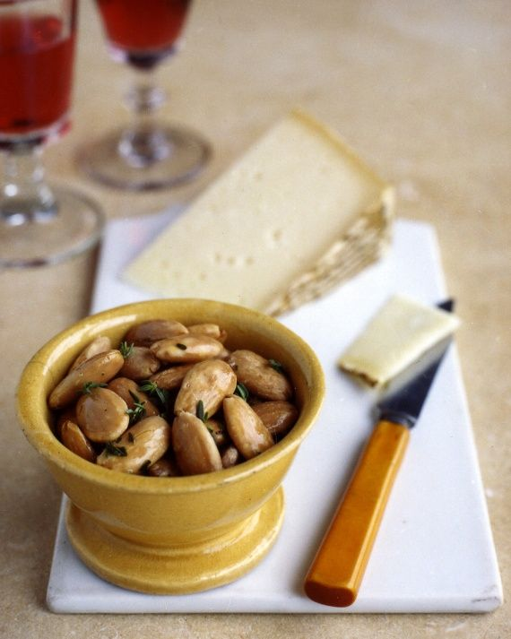 Fried Herbed Almonds: These crunchy thyme-flecked nuts are delicious served with sherry and slices of manchego cheese.