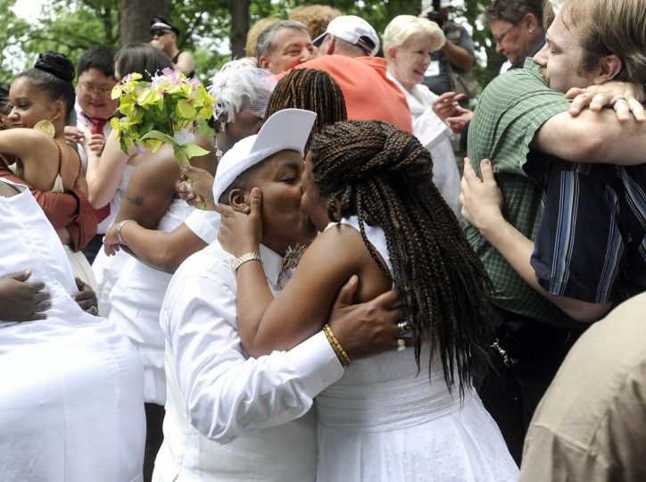 Congrats to Rhoda Blocker, left, and Allison Fisher, who were married during a mass same-sex wedding ceremony conducted during Baltimore Pride Festival.