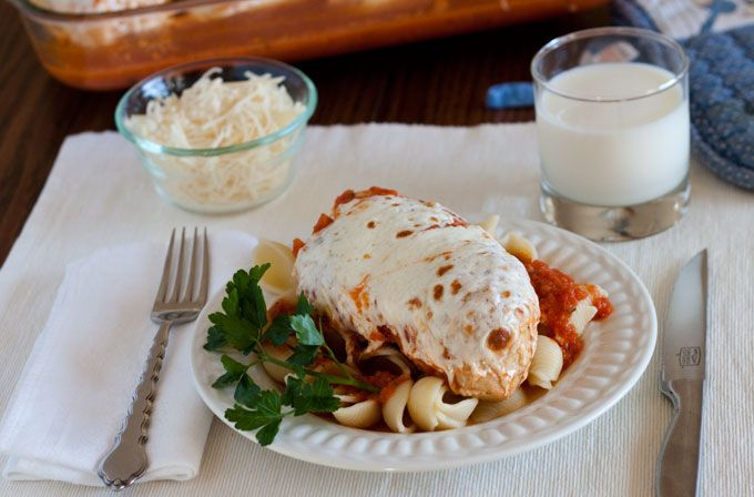 Chicken breasts cook in only five minutes in the pressure cooker, smothered in a marina sauce then topped with melted mozzarella cheese.