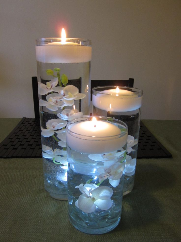 with purple orchid and calla lily....we could do this!  White Orchid Floating Candle Wedding Centerpiece Decor. $55.00, via Etsy.