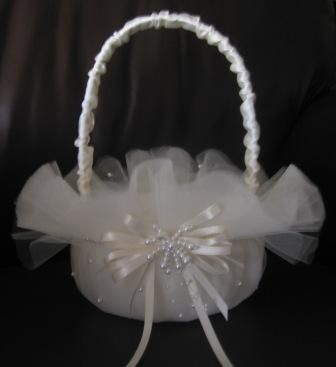 Layers of tulle make for a beautiful flower girl basket accented with pearls and…