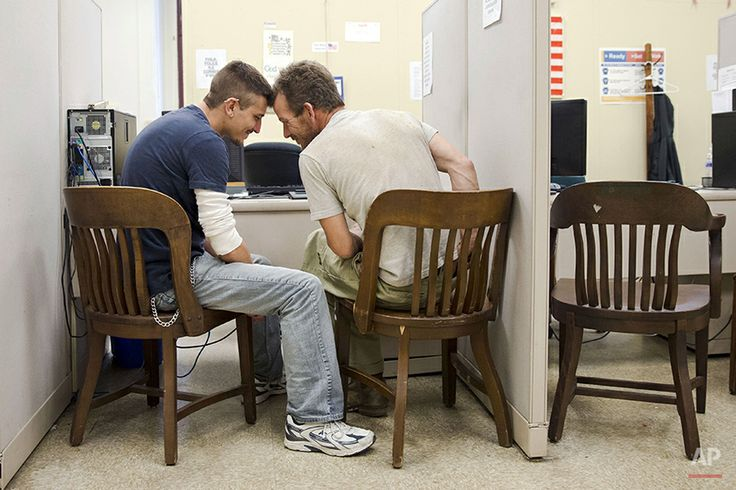 William Roletter, left, and Paul Rowe, press close to one another as they apply for their marriage certificate, Wednesday, May 21, 2014, at ...