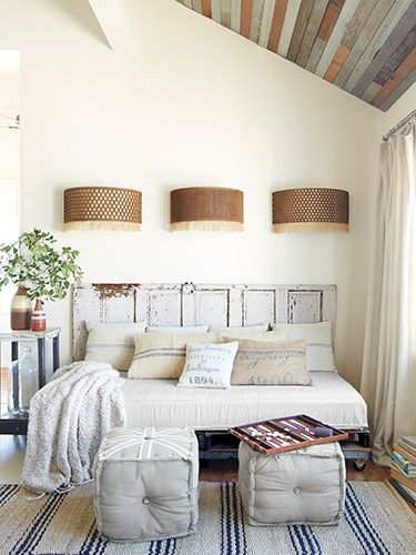 Smoot fashioned the frame of the daybed using a $25 flea-market door and pallets. The pillowcases? Old grain sacks, natch.