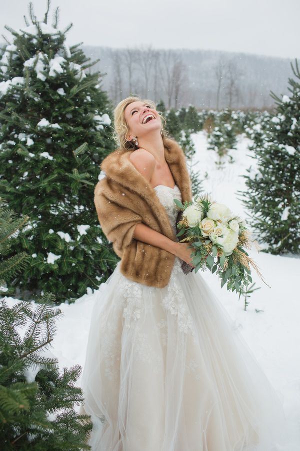 A gorgeous Oleg Cassini gown and fur coat complete this bride's stunning snowy portrait! LOVE!