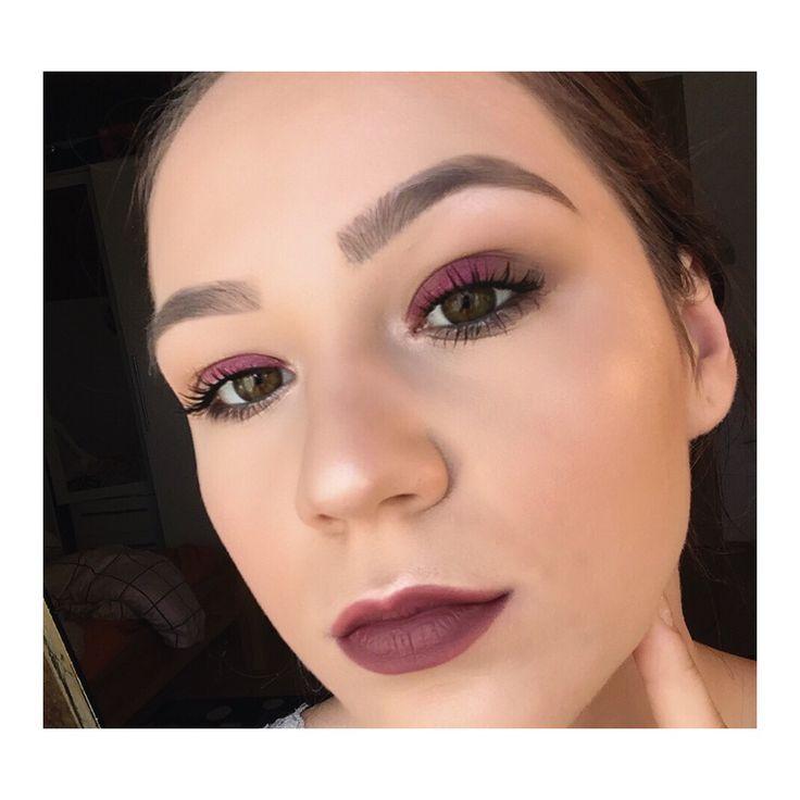 Burgundy makeup look with dark lips.