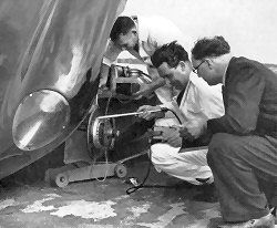 Mikes Jaguar D-type, XKD 505, having its tyres checked by a Dunlop team during practice