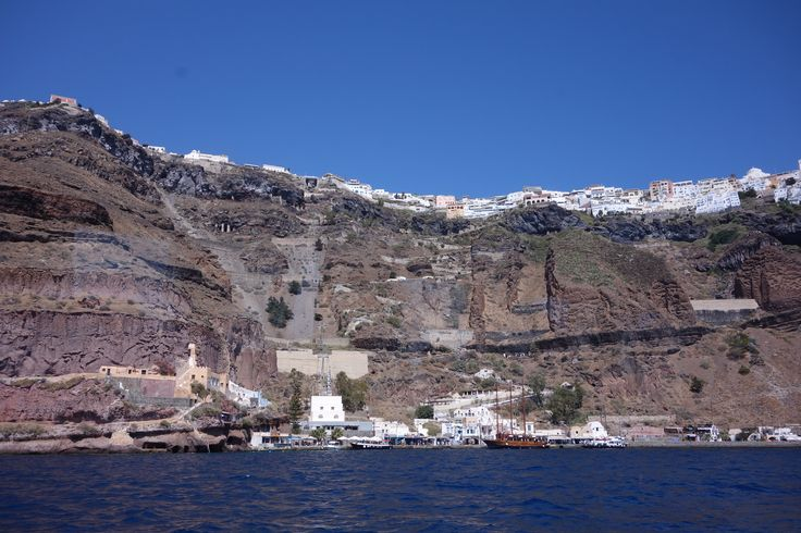 This first glimpse of Santorini never gets old.  ..well it's thousands of years old but every time I go there I am mesmerized.