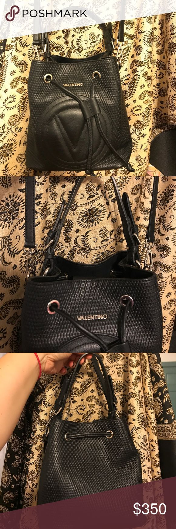 Valentino by Mario 🖤black leather crossbody🖤 Authentic  Black Mario Valentino leather Crossbody bucket bag excellent condition only worn a few times purchased this year from off Saks Fifth Avenue comes with dust tag receipt and all tags adjustable top leather strap- 🖤🖤🖤two zip compartments one side pocket ! Medium sized bag silver hardware Valentino Bags Crossbody Bags