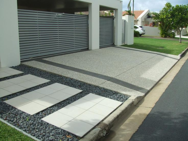 Concrete Driveway Design Ideas eminent construction offers latest color designs pictures ideas and much more for concrete driveway installation get your old concrete driveway repaired Hipagescomau Is A Renovation Resource And Online Community With Thousands Of Home Driveway Designdriveway Ideasdriveway Materialsconcrete