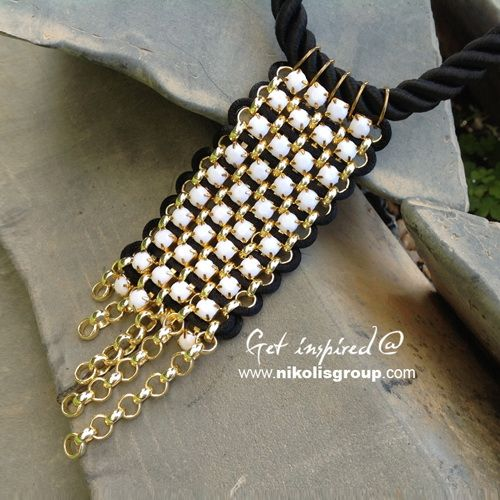 detail from impressive necklace, find the materials @ www.nikolisgroup.com