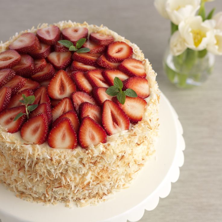 Sweet strawberries are delicious with this coconut cake frosted with a light cream cheese frosting. The flavors are perfectly balanced and t