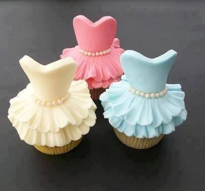 Yellow, pink, and blue cupcake dresses with, pearls on them.
