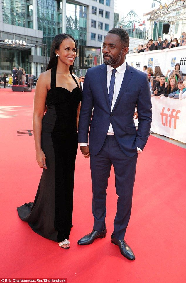 Never say never:Idris Elba, 45, ENGAGED to beauty queen girlfriend Sabrina Dhowre, 29, (pictured in Canada, September 2017) after he insisted he would NEVER marry again